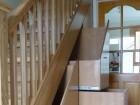 white oak  bannisters & understairs storage